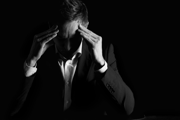 depressed overworked stressed tired businessman suit pastor black and white courtesy of shutterstock com Lichtmeister_72661231